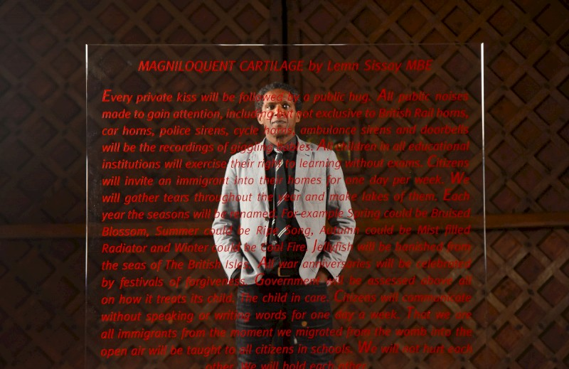lemn_sissay_with_his_poem_photo_by_zachary_culpin.jpg