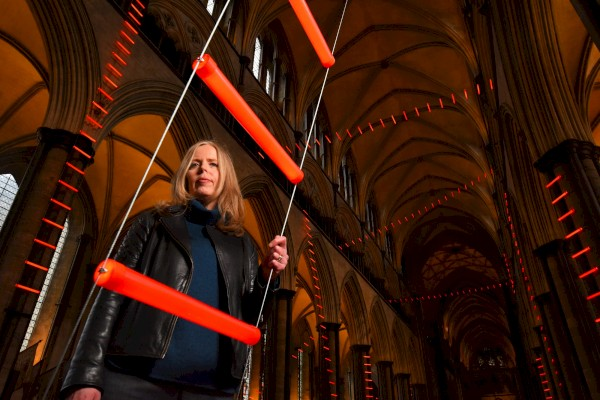 artist_mary_branson_with_ladders_of_light-_part_of_the_sky_arts_50_installation_in_salisbury_cathedral_-_photo_by_zachary_cu.jpg